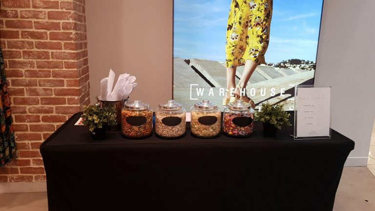 Jars of Kacang Puteh on service table