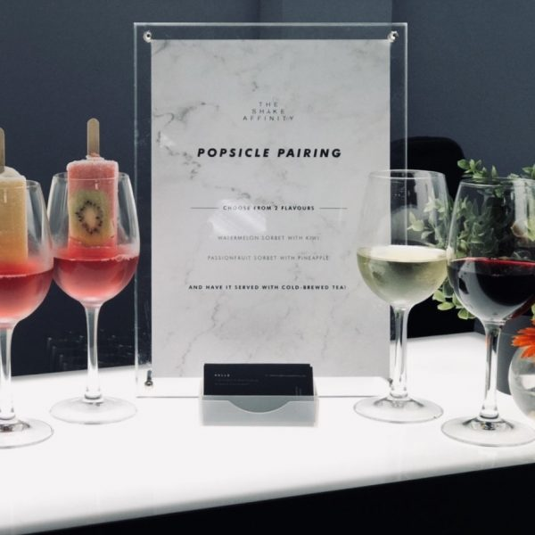 Close up of wines paired with popsicle on mobile bar counter